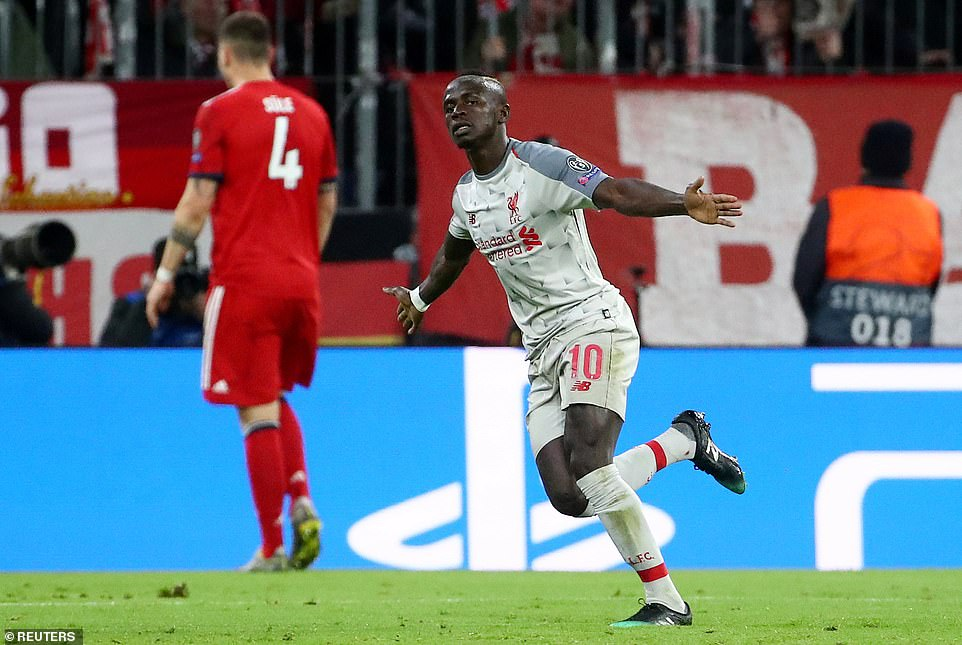 Liverpool's Senegalese winger wheels away in celebration after giving his team a crucial away goal in Germany