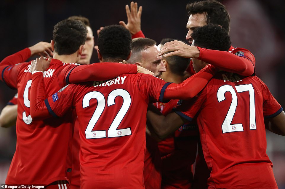 The Bayern Munich players celebrate the equaliser together after getting themselves back into the game before half time