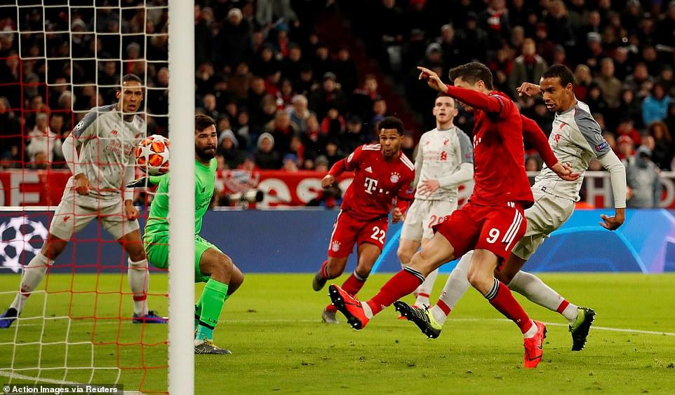 Before it can reach Lewandowski, Liverpool defender Joel Matip tries to intercept the ball but scores an own goal