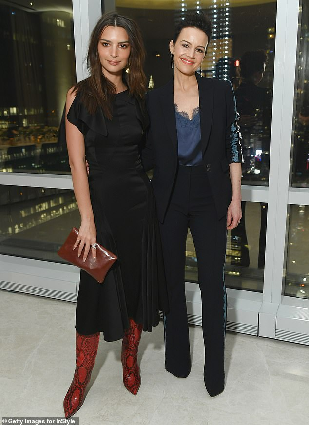 Look at that view: Emily stopped for a photo with Carla Gugino, 47, standing in front of a window showing the New York skyline behind them