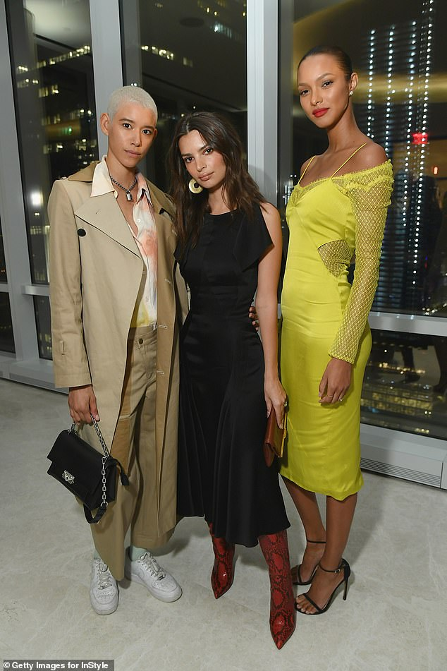 Three babes: Emily impressed with one of her model poses while snapping a picture with models Dilone, 24, and Lais Ribeiro, 28