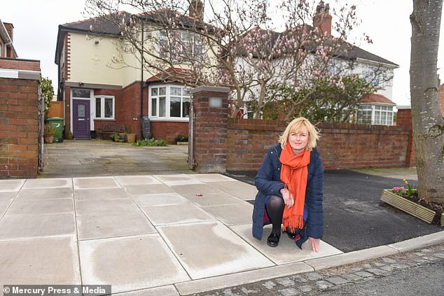 HelenMaloney (pictured with her new drive), 53, had to pay to have a dropped kerb installed outside her three bedroom detached home in Southport, Merseyside after she was toldshe couldn't legally park on the drive due to it being two inches (5cm) too high