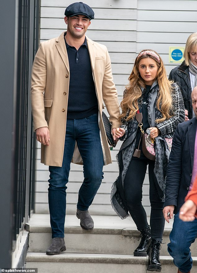 Stunner:She added inches to her frame with a pair of towering black leather platform heeled boots, as she strutted out of the restaurant with her reality star beau