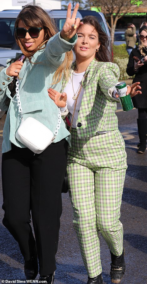 These ladies have already been hitting the gin and tonics as they rocked up for a day of festivities