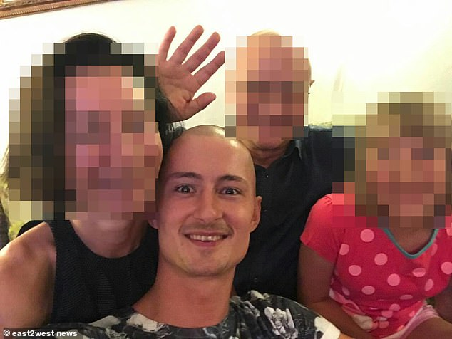 Belorusov (pictured) is being held by police in the Estonian capital Tallinn while UK authorities attempt to extradite the barman to quiz him over the killing of his former partner