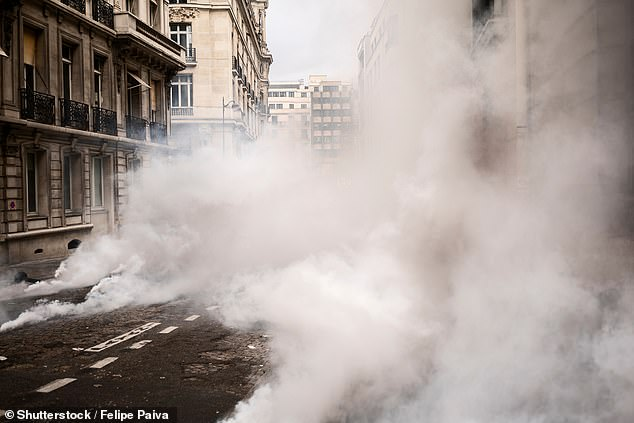 Tear gasis a chemical weapon that causes severe eye and respiratory pain, skin irritation, bleeding, and even blindness. In the eye, it stimulates the nerves of the lacrimal gland to produce tears and is often used by police to break-up riots