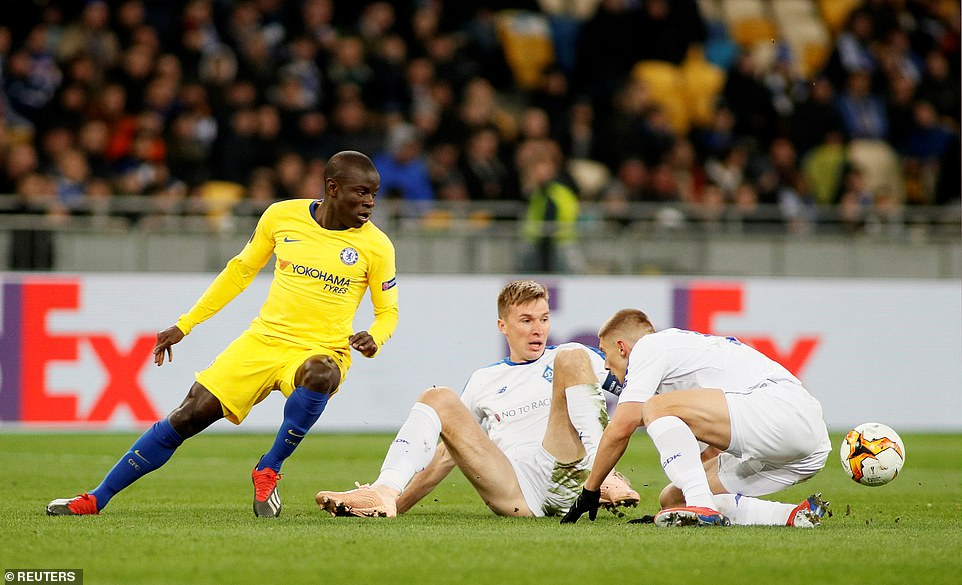 Chelsea midfielder N'Golo Kante seeks to win the loose ball withSerhiy Sydorchuk and Vitaliy Mykolenko on the floor