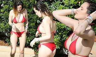 Bella Thorne flaunts her eye-popping figure in a red string bikini