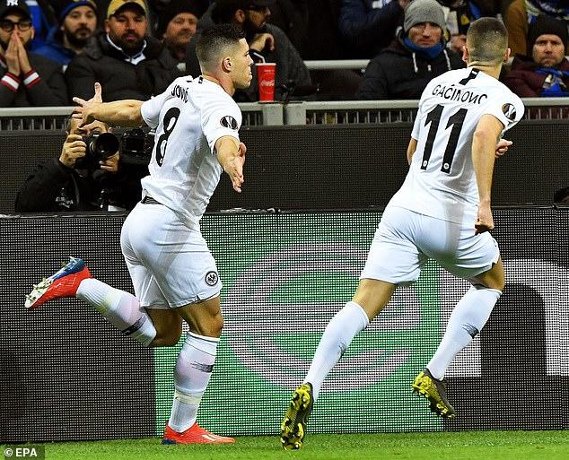 Frankfurt's Serbian striker (left) wheels away in celebration after giving his side the lead