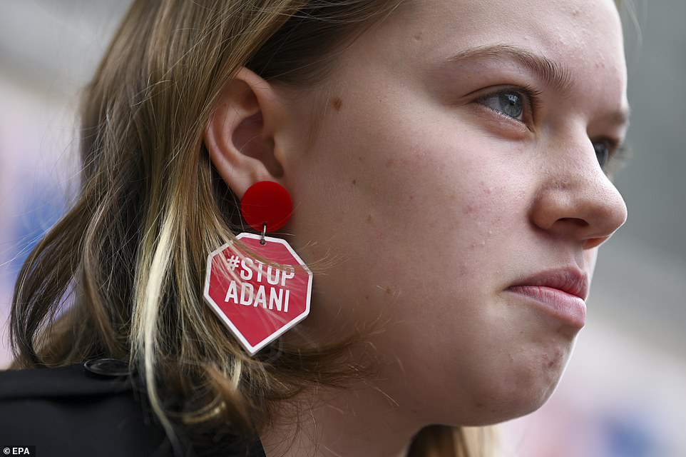 'Stop Adani, stop stop Adani,' the protesters chanted in reference to the Adani coal mine