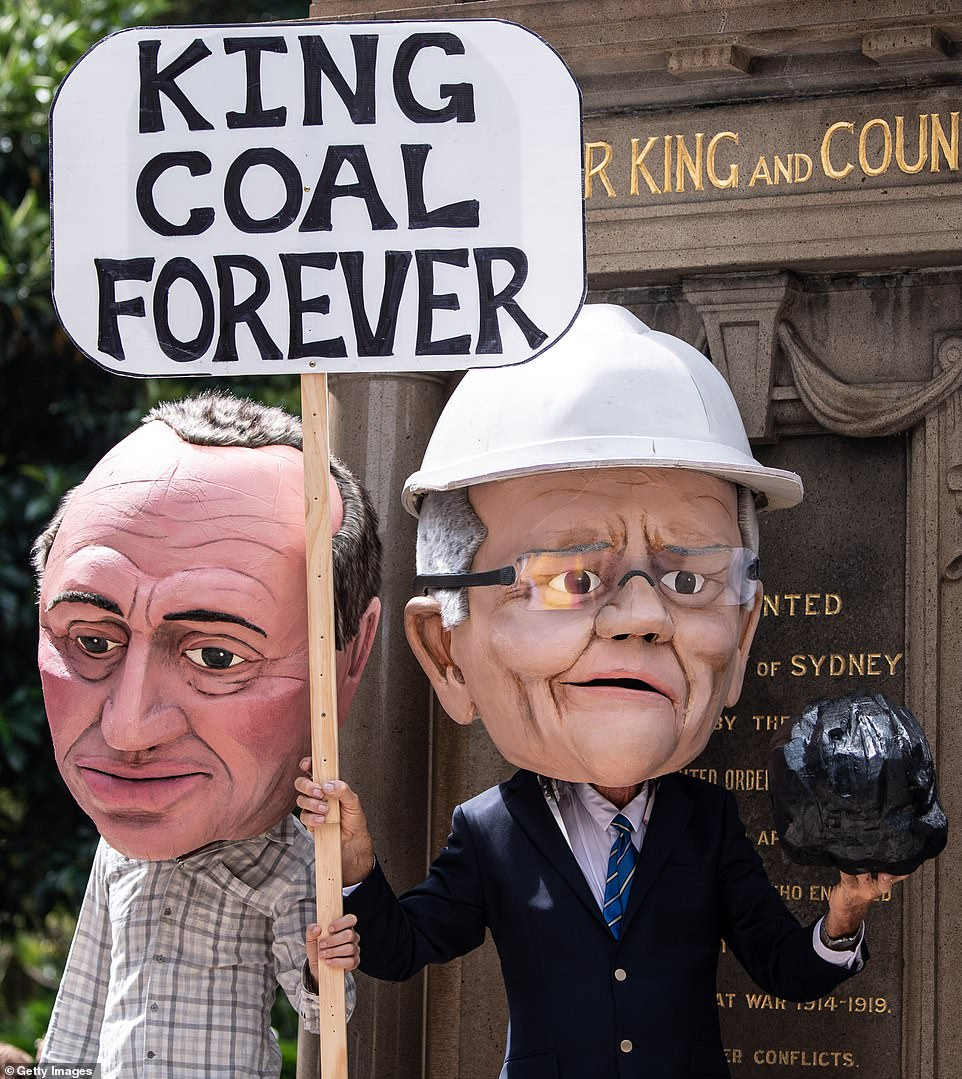 Protesters dressed as Barnaby Joyce and Scott Morrison greeted protesters in Sydney when they descended on Hyde Park