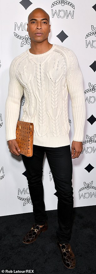 Svelte figure: Extra host Dorion Renaud arrived in a textured white sweater, black jeans and black and gold loafers