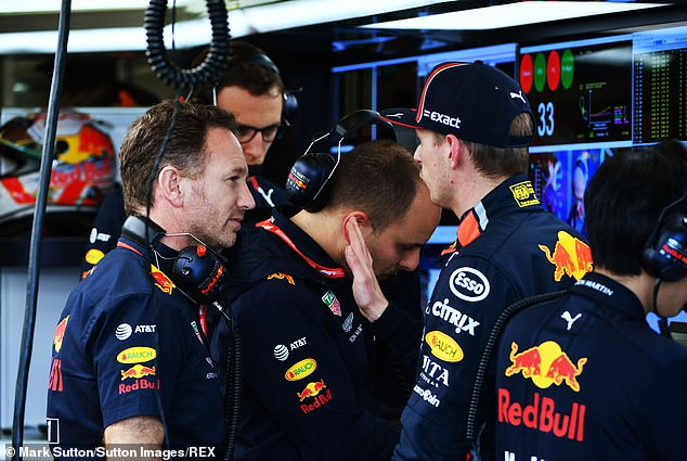 Max Verstappen talks to Red Bull Team Principal Christian Horner in the pit lane