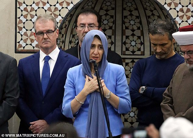New South Wales Premier Gladys Berejiklian (pictured middle) was among multiple politicians in attendance to pay their respect