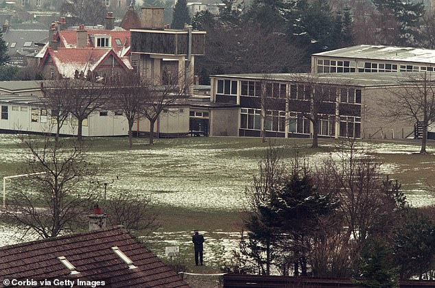 A police officer stands guard at Dunblane primary school in Stirling, Scotland, shortly after the shooting incident on 13 March 1996