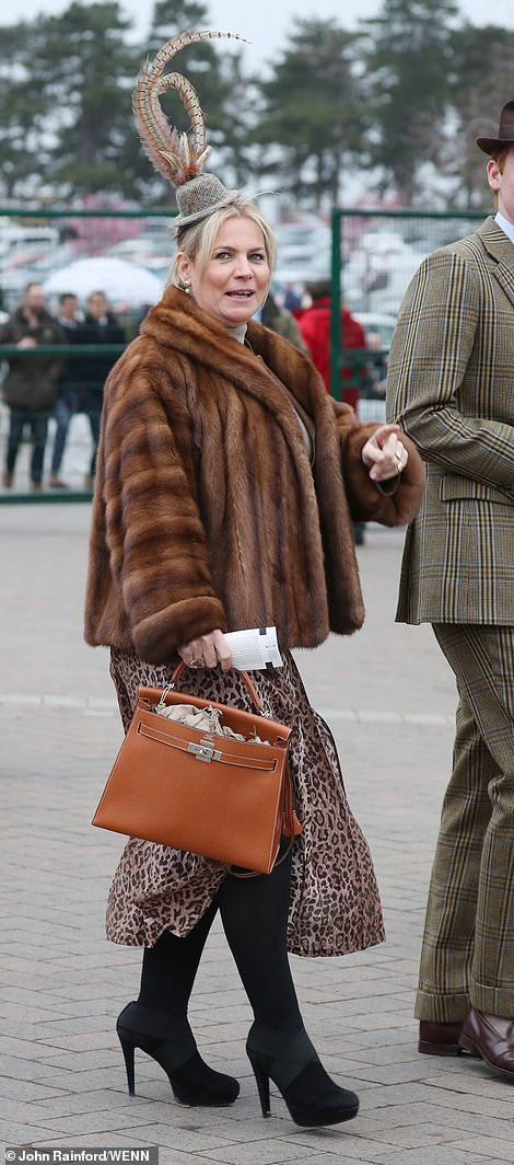Feeling furbulous: Fur was very much on-trend, with revellers sporting cosy coats, fuzzy boot toppers and warm scarves