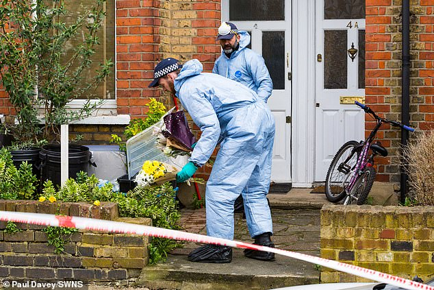 Police officers search the front garden of the Kew home where Ms Garcia-Bertaux was found