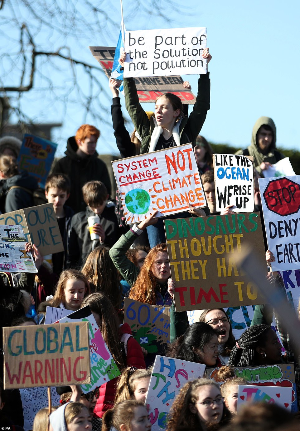 In Edinburgh, protesters demonstrate outside the Holyrood Scottish Parliament where temperatures sat at a biting 5C
