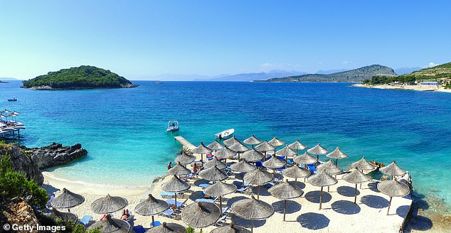 Sunny place, shady people: Ksamil beach, near the archaeological city of Butrint is an example of the beautiful places that the Albanian tourism board say belie its fictional reputation