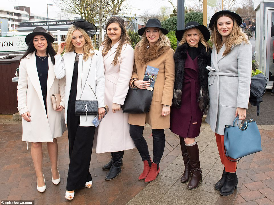 Rain, rain, go away! These ladies defied the wet weather as they turned out wearing smart hats, coats and fur stoles