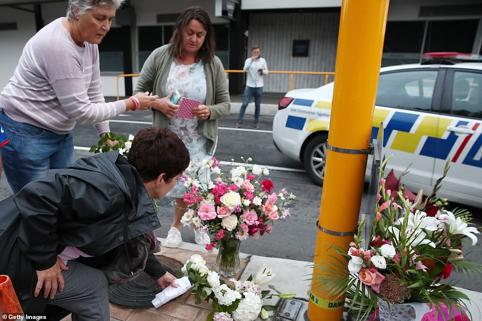 Local residents leave floral tributes at Deans Avenue near the Al Noor Mosque on March 16, 2019 in Christchurch, New Zealand. At least 49 people are confirmed dead