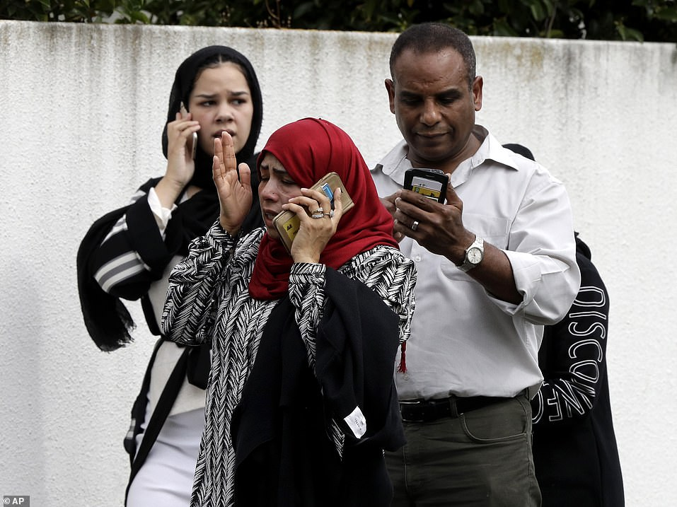 The country's police commissioner, Mike Bush, said 49 people were confirmed dead and that a man in his late 20s has been charged with murder. Pictured: A tearful woman waits outside the mosque on Friday