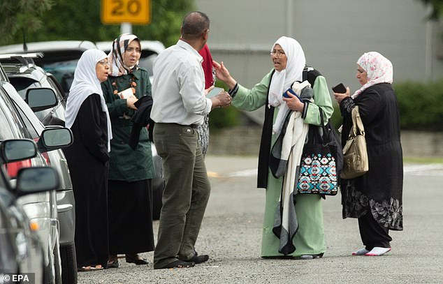 Shocked family members stand outside the mosque following a shooting resulting in multiple fatalies and injuries at the Masjid Al Noor on Deans Avenue in Christchurch