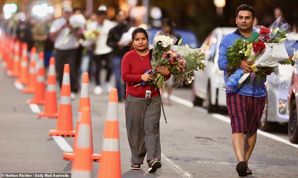 Those who gathered at the vigil helped to being the floral tributes closer to the mosques where 49 people lost their lives during the shooting