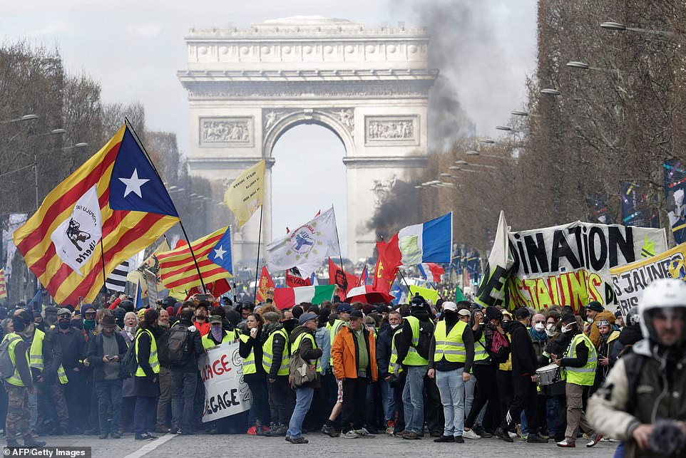 Violence erupted in Paris today as Yellow Vest protesters calling for French President Emmanuel Macron to resign took to the streets for the eighteenth Saturday in a row