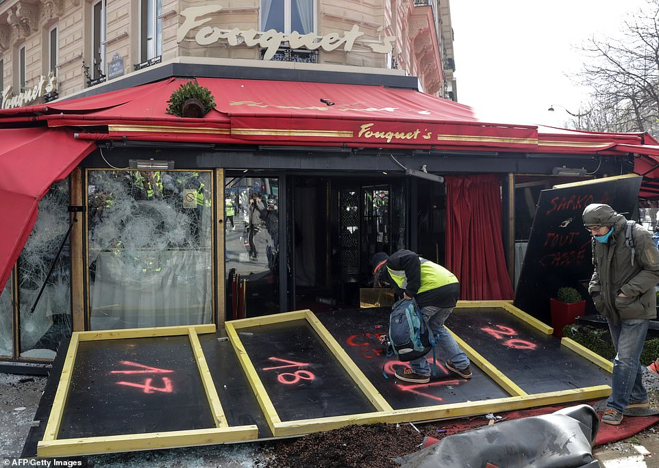 Exclusive restaurant Le Fouquet, popular with politicians and celebrities was also vandalised