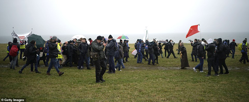 The group battled strong winds and rain as temperatures fell to 10 degrees celsius at the start of the 270-mile walk