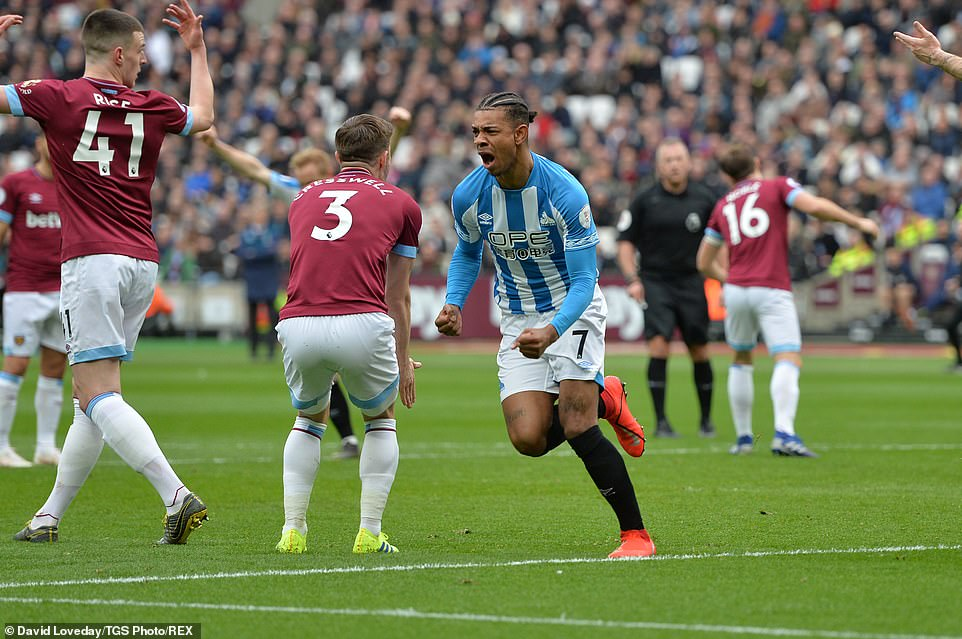 Juninho Bacuna is delighted after he scored to pull Huddersfield level in their clash against West Ham