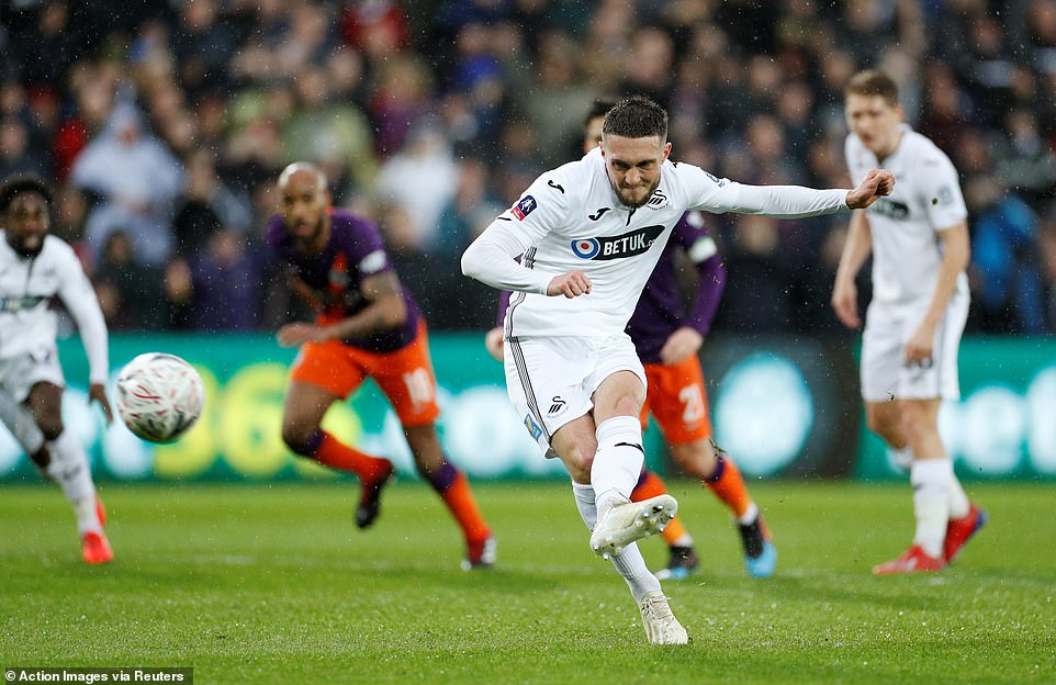 Matt Grimes scores from the penalty spot to put Swansea in the lead in their FA Cup tie against Manchester City