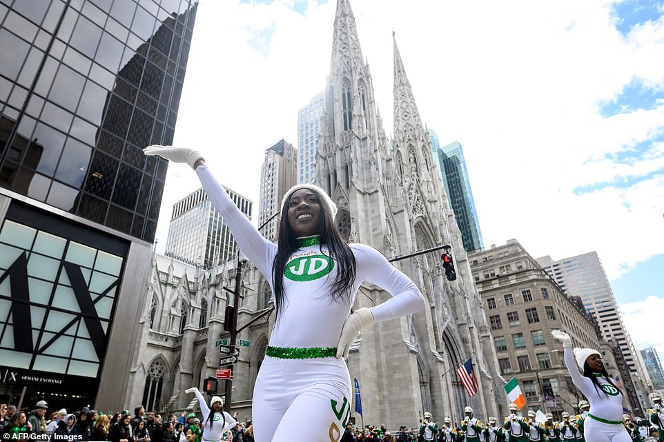 Dancers perform on 5th Avenue passing the St. Patrick's Cathedral on 51st during the annual New York City event