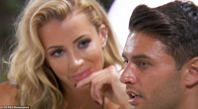 Olivia Attwood gazes at Mike Thalassitis during the third series of Love Island, with rumours flying about a potential romance between the pair