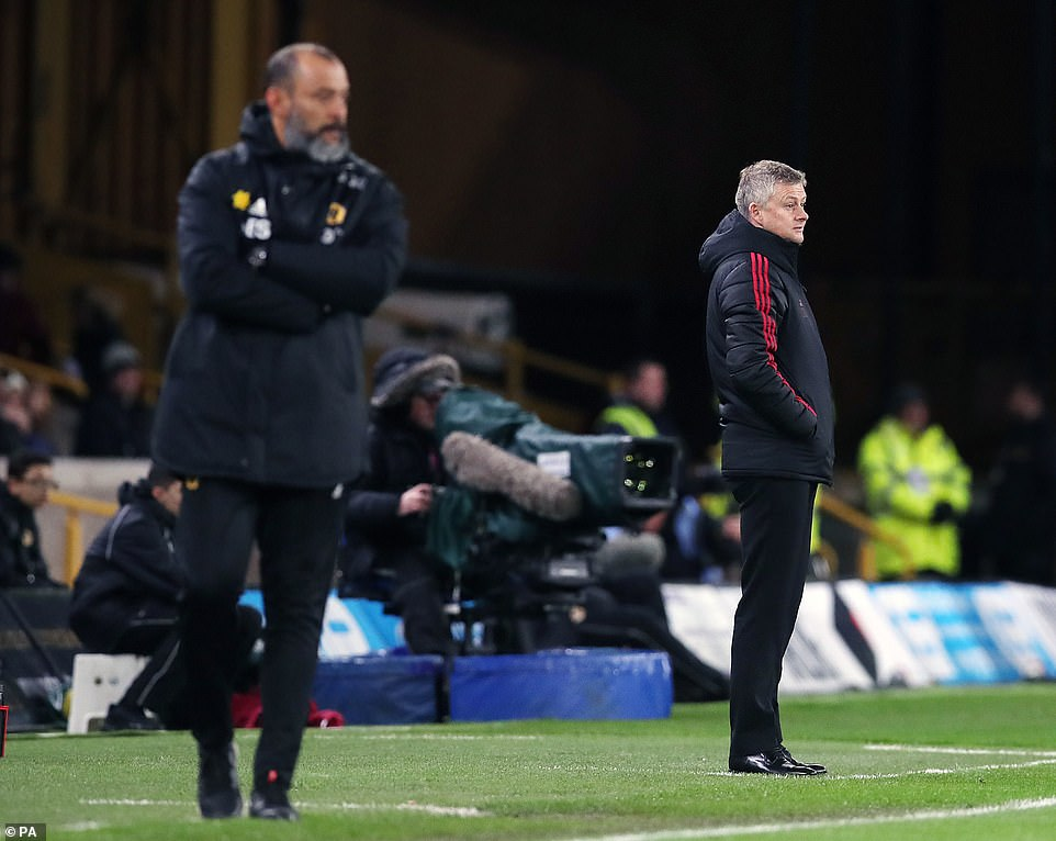 Manchester United interim manager Ole Gunnar Solskjaer (right) and Wolves bossNuno Espirito Santo on the touchline