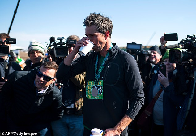 O'Rourke sips water after finishing the Lucky Run 5k race on Saturday in North Liberty, Iowa