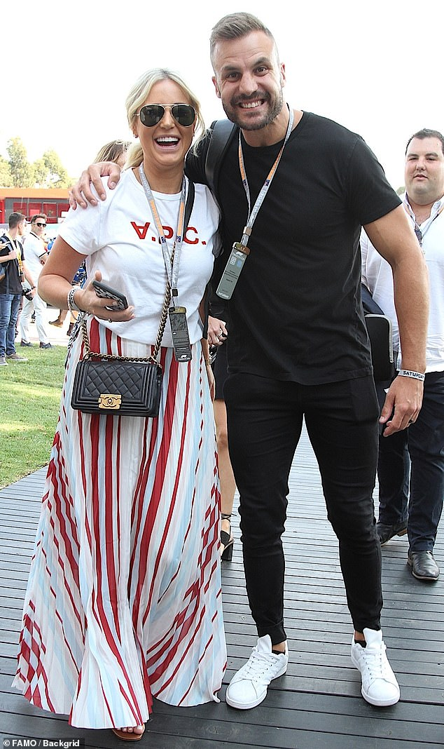 Wearing her racing stripes! PR maven Roxy Jacenko (L) looked festive in red-and-white stripes as she and Beau Ryan watched the Australian Formula One Grand Prix in Melbourne on Saturday