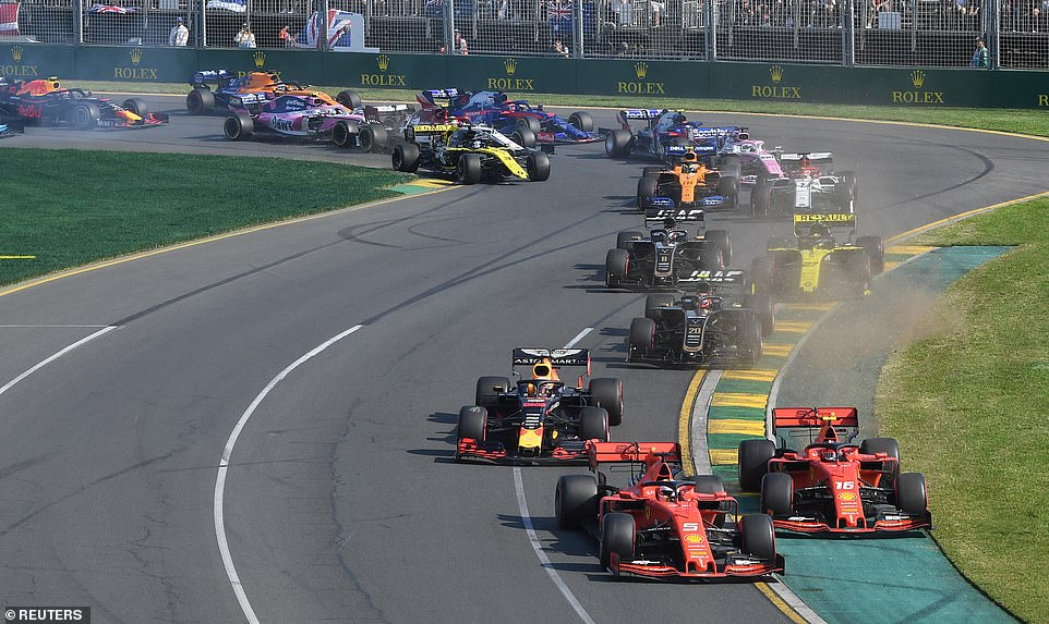 The cars jostle for position in the opening couple of corners in Melbourne with the Ferraris of Vettel and Leclerc in front