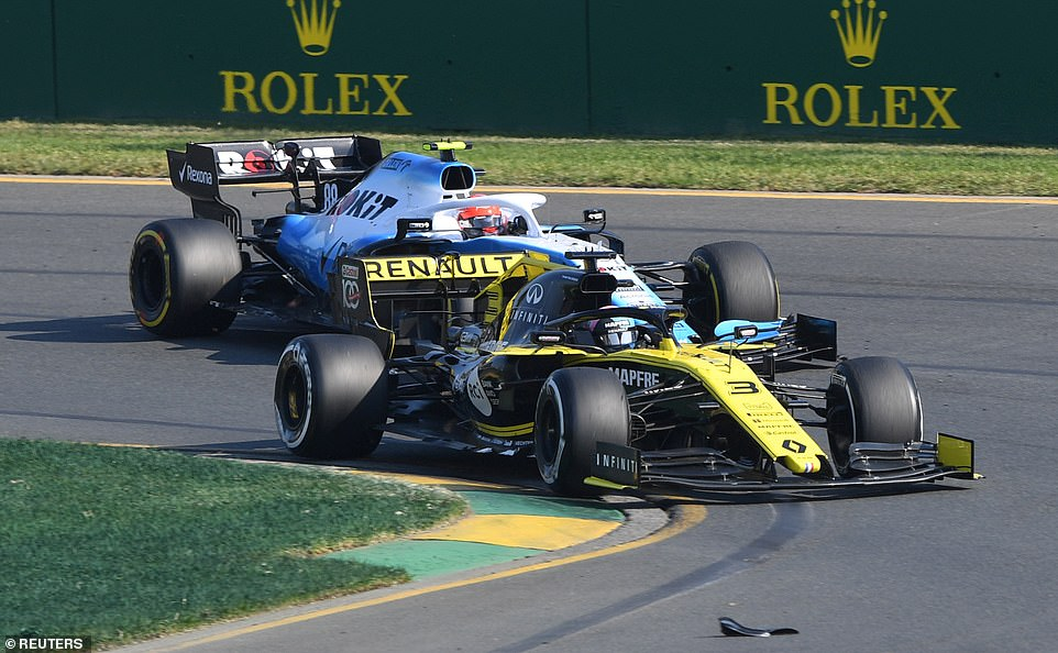 Renault's Daniel Ricciardo overtakes during the first turn of the Australian Grand Prix - he would be forced to retire though