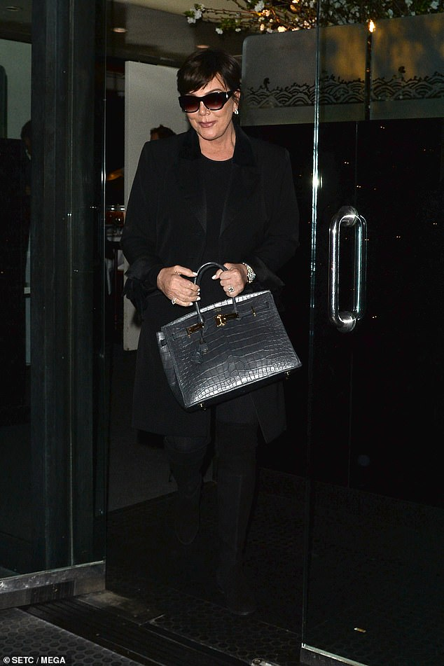 Check her out: Kris made a statement with her grey rectangular handbag, yet she kept her dazzling jewellery to a minimum as she only opted for a silver watch and earrings