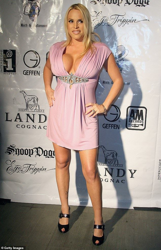 Ms Billard (pictured in 2008, aged 32) first had breast enlargement surgery when she was 18 in 1993, which gave her DD breasts. But she said she suffered with capsular contracture, which happens when the immune system reacts badly to the implants