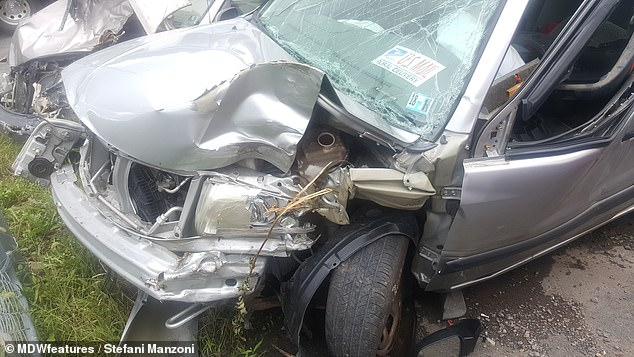 Mrs Manzoni suffered a seizure which allegedly affected her thinking, causing her to drive up an embankment, which triggered her airbag. She claims it made her perform a 90 degree turn across the highway, where she crashed into a tree (pictured, the damage to her car)