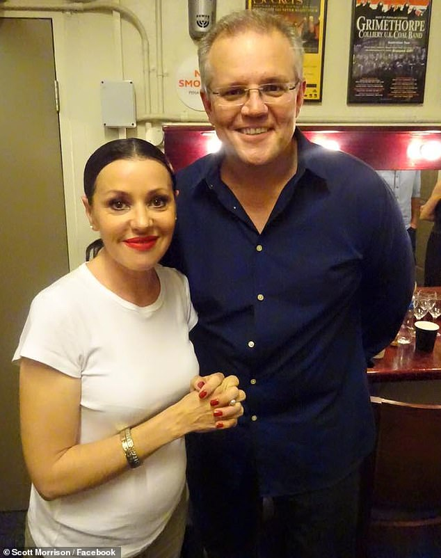 'She's my favourite': Prime Minister Scott Morrison, 52, (right) praised Tina Arena, 52, (left) on Thursday for being 'an amazing Australian artist'