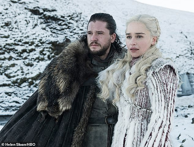 Terrifying: Emilia then explained that she had just finished filming the first season of the HBO fantasy series when she had her initial brain aneurysm while working out with a trainer (pictured with Kit Harington (Jon Snow) during filming for Game Of Thrones)
