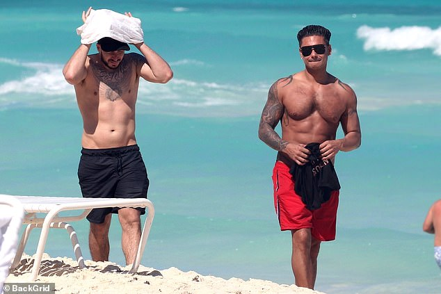 Taking rays: Vinny seemed to have taken off his shirt during his sunny walk