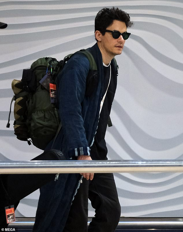Down Under: American singer-songwriter John Mayer, 41, was pictured jetting into Auckland on Thursday, ahead of the New Zealand and Australian leg of his world tour