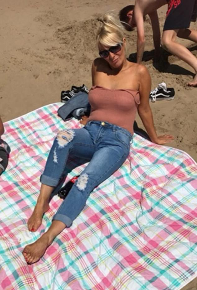 Rachael Thomas, 45, who was told a giant grwoth in her womb was benign is now fighting for her life after doctors discovered it is in fact an aggressive cancer. Pictured last year