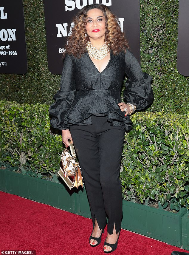Elegant matriarch: Tina stunned in an elegant, low-cut black blouse with covered in a honeycomb pattern for the event, which collects work from black artists ranging from civil rights