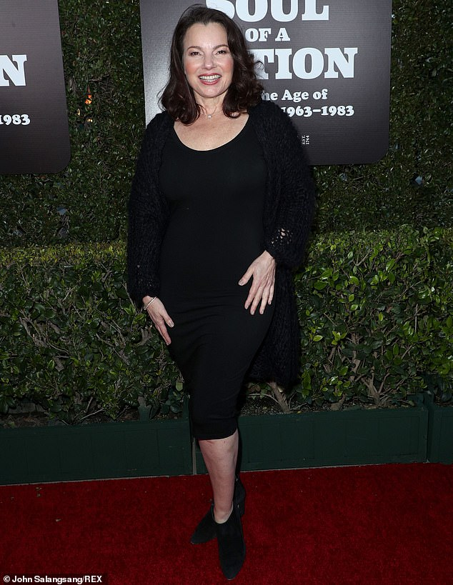 Classic look: Actress and comedian Fran Drescher went with a timeless all-black look for the opening. She had a black form-hugging and covered up with a cozy knit cardigan